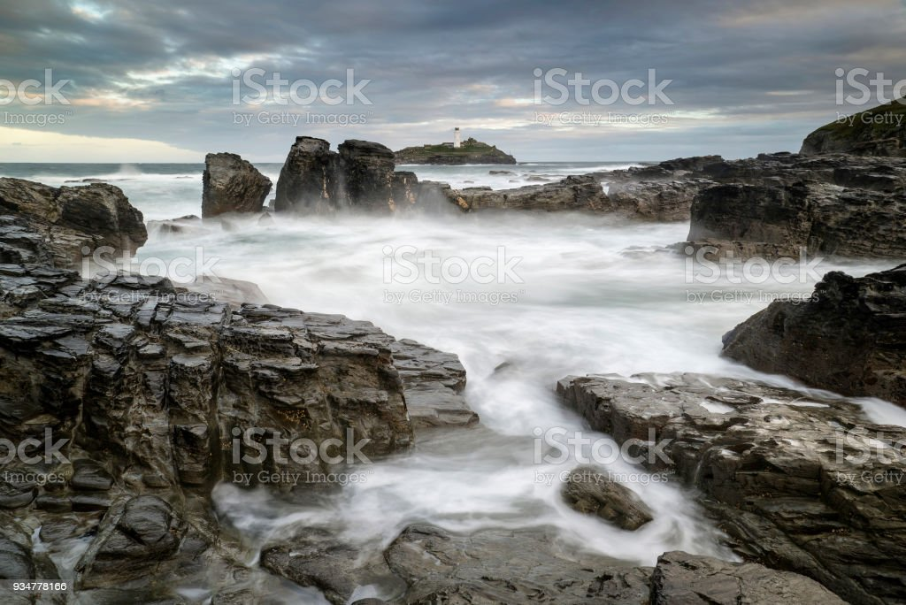 Landscape view of Godrevy lighthouse in Cornwall during lovely sunrise stock photo