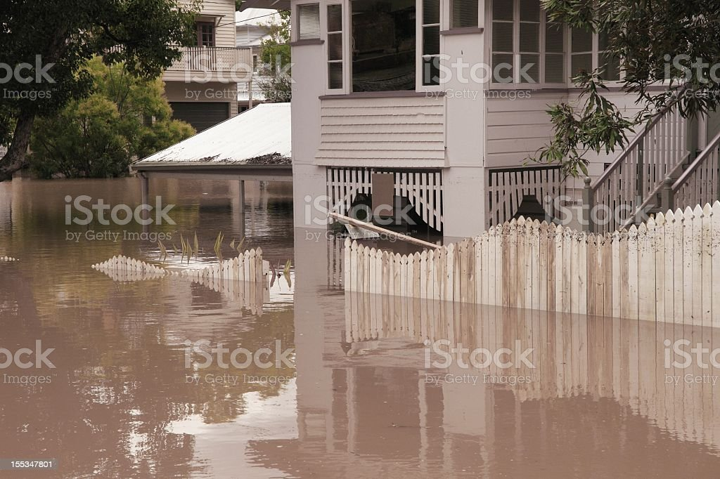 Landscape view of house flooded several feet deep stock photo