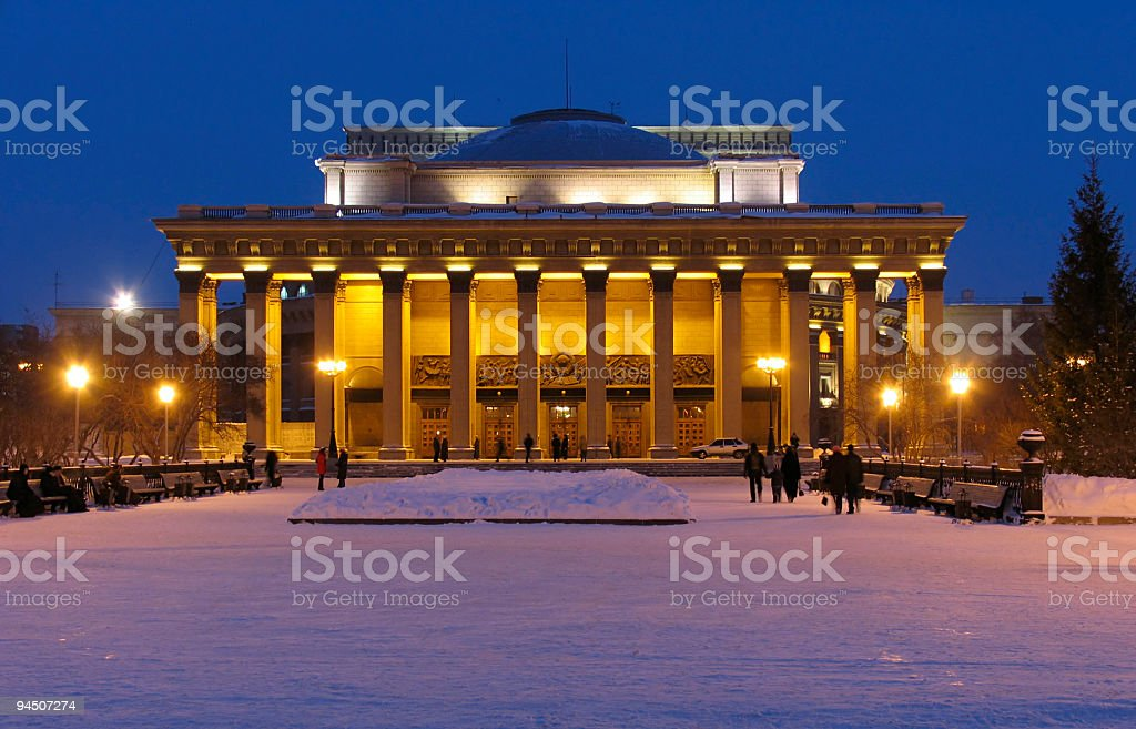 Landscape view of illuminated theater building at dusk stock photo