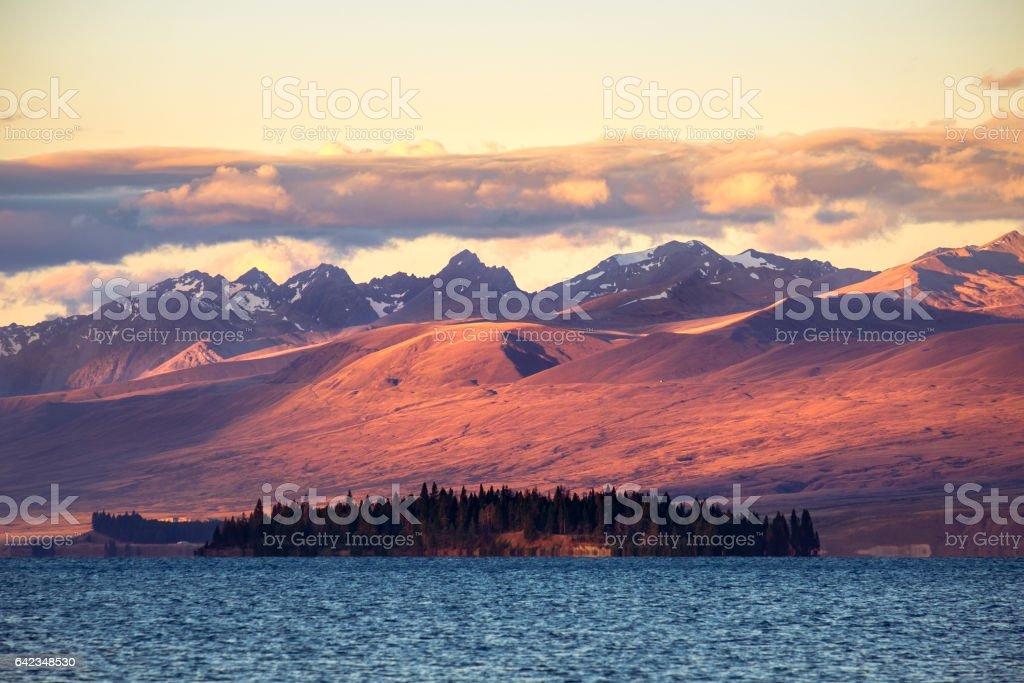 Landscape view of Lake Tekapo and mountains at sunset stock photo