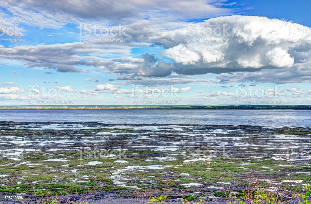 Landscape view of Saint Lawrence river from Ile D'Orleans, Quebec, Canada in summer with green plants stock photo