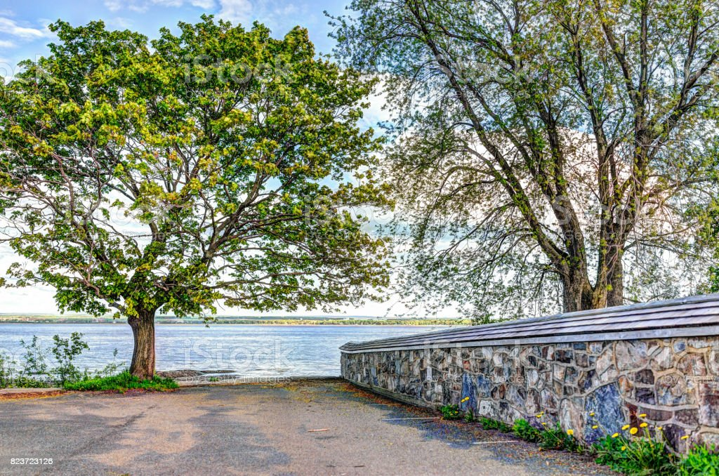 Landscape view of Saint Lawrence river from Ile D'Orleans, Quebec, Canada in summer with stone church wall stock photo
