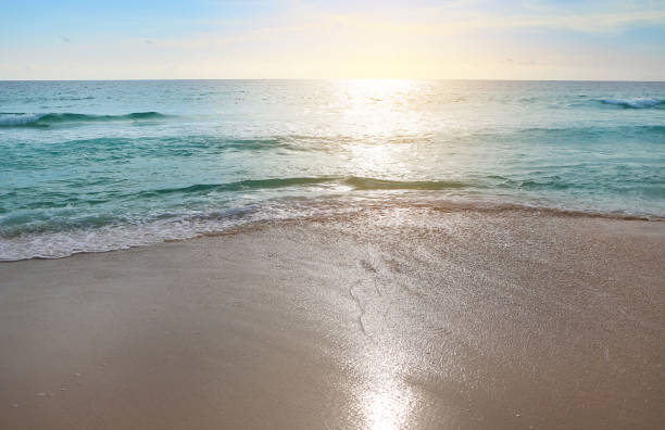 Landscape view of sea wave on the beach sand at sunset. stock photo
