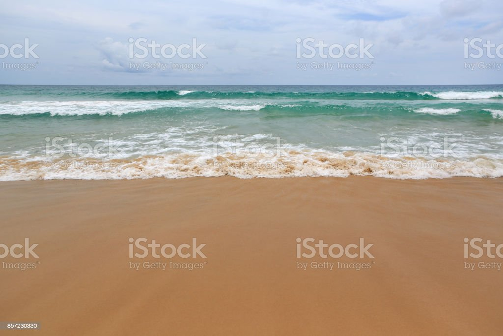 Landscape view of sea wave on the beach sand. stock photo