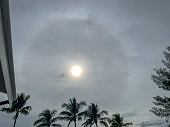 Landscape view of stunning sun halo over RV park in Florida during hazy autumn afternoon