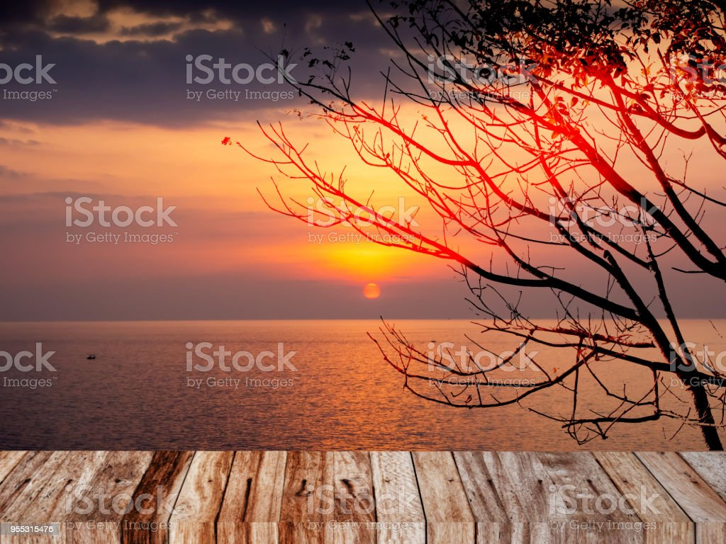 Landscape view of sunset at the sea with wood plank and copyspace stock photo