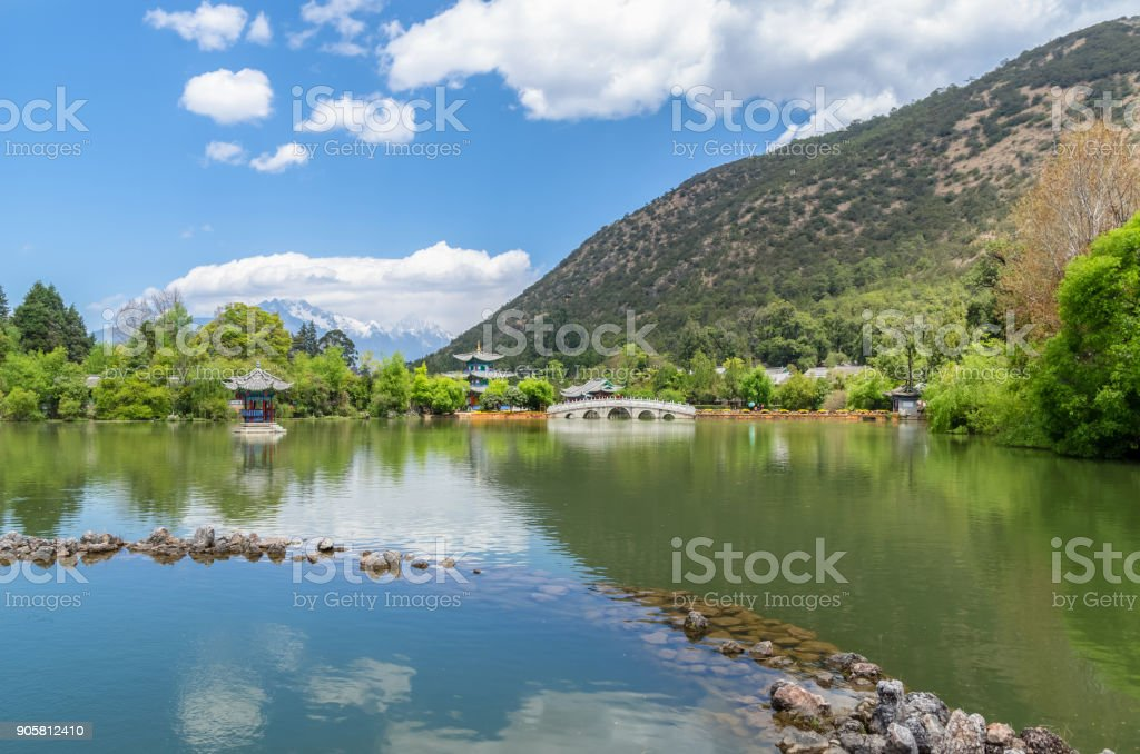 Landscape view of the Black Dragon Pool, it is a famous pond in the scenic Jade Spring Park located at the foot of Elephant Hill,Lijiang China. stock photo