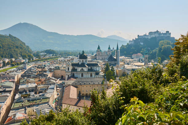Landscape view of the city of Salzburg in Austria with a cathedral and a castle in the background. stock photo