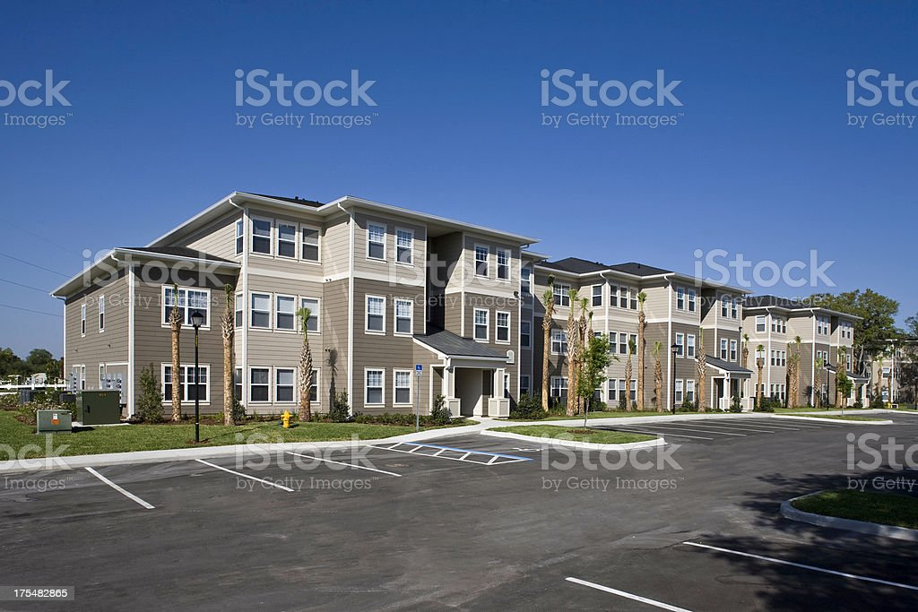 A landscape view of the exterior of a new apartment complex stock photo