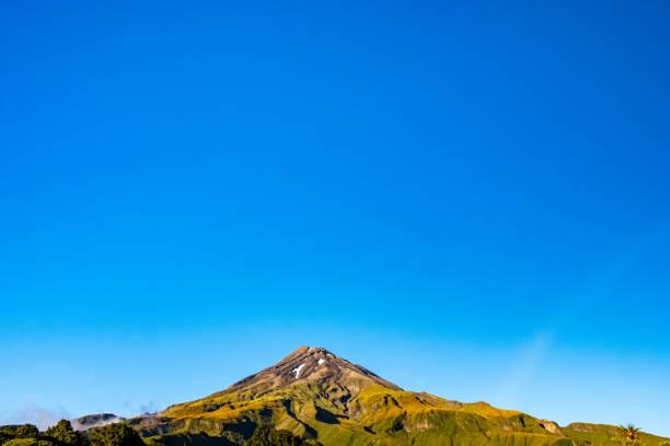 Landscape view of the Taranaki Volcano in the summer. stock photo