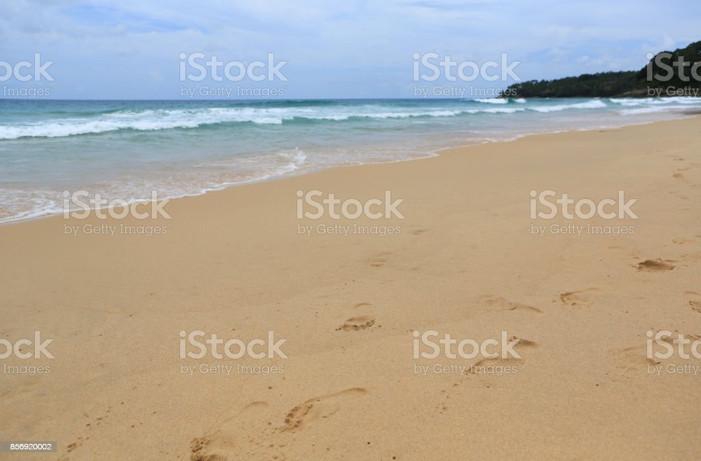 Landscape view of the tropical sea at the summer with foot print in the sand beach. stock photo