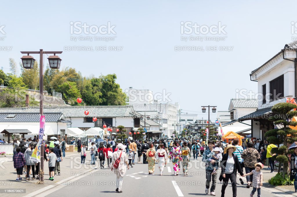 landscape view of tourist crowd in traditional event festival street...