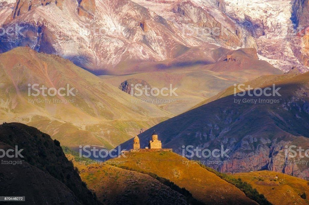 Landscape view of Tsminda Sameba church in Kazbegi, Georgia stock photo