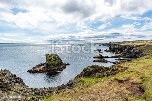 istock Landscape view rocks in ocean on coast in Hellnar National park Snaefellsnes Peninsula coastline in Iceland with green grass on summer day 1097504946