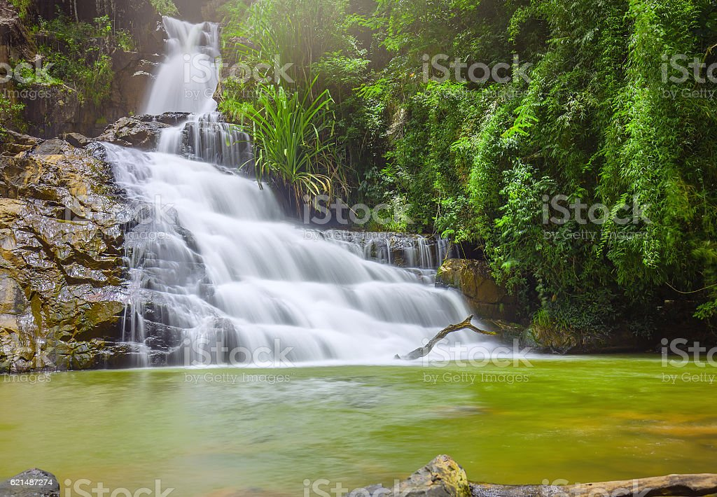 Landscape waterfall flowing into soft silk sheet foto stock royalty-free