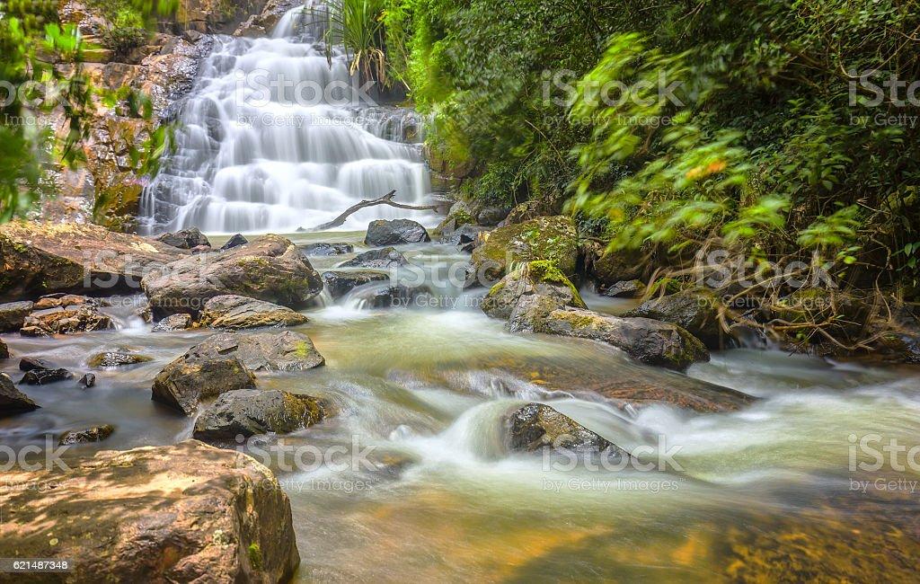 Landscape waterfall flowing into soft silk sheet foto stock royalty-free
