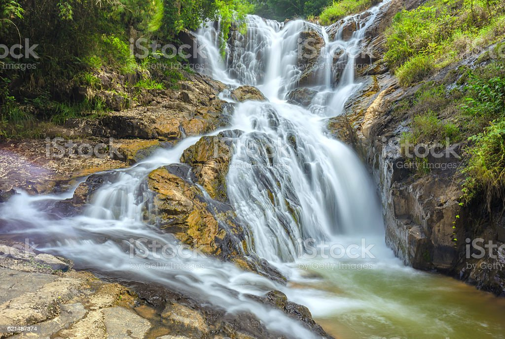 Landscape waterfall flowing into soft silk sheet Lizenzfreies stock-foto