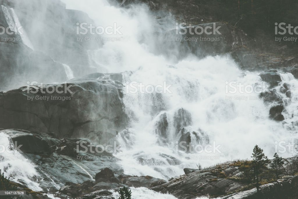 Landscape Waterfall in Norway rocky mountains Travel serene scenic...