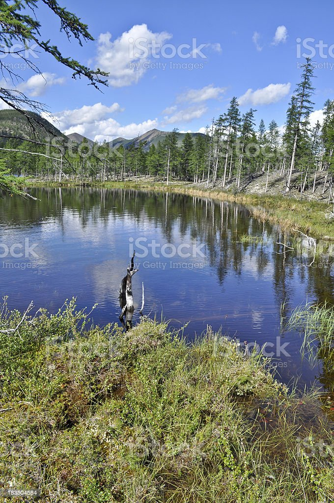 Landscape with a lake and mountains along the banks. royalty-free stock photo