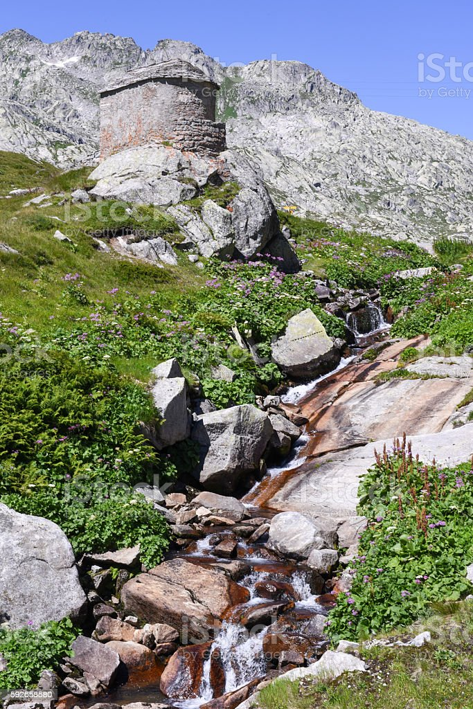 Landscape with a river at St. Gotthard pass stock photo