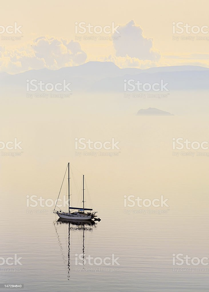 Landscape with a sailboat in delicate colors royalty-free stock photo