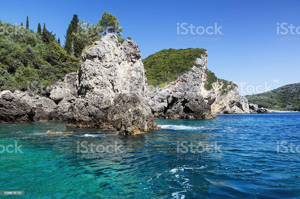Landscape with azure clear sea and rocks, Paleokastritsa, Corfu, Greece stock photo