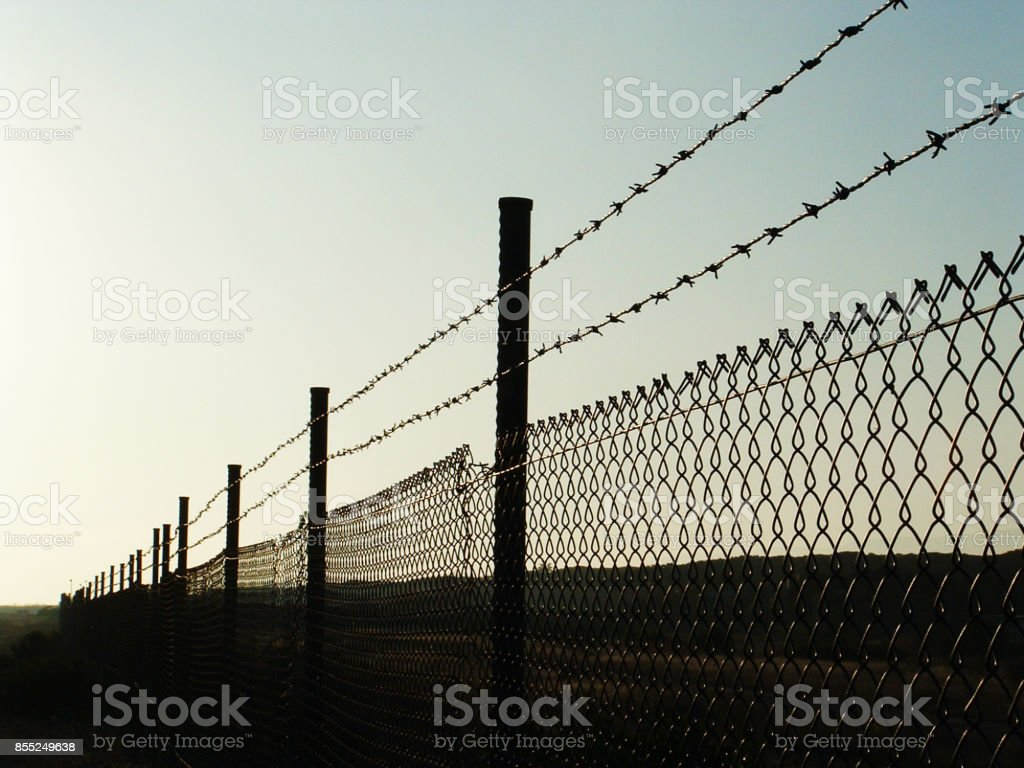 landscape with barbed wire /fence on sunset stock photo