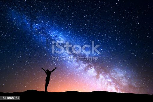 istock Landscape with blue Milky Way and silhouette of a girl 541868264