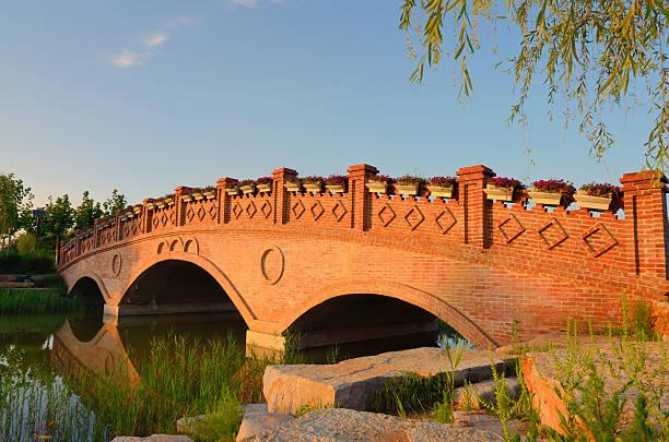 Landscape with brick arch bridg stock photo
