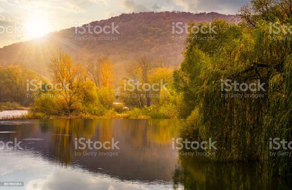 landscape with calm river in autumn at sunset stock photo