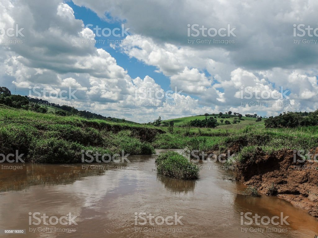 Landscape with Clouds above Rural Fields stock photo