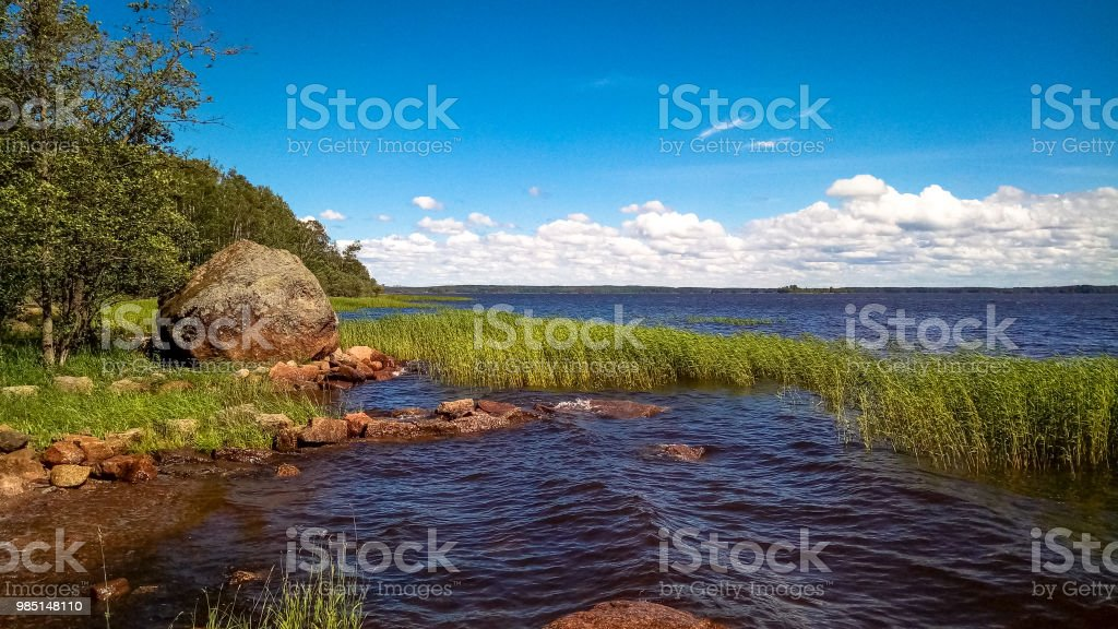 Landscape with cold sea in sunny weather with clouds in the sky
