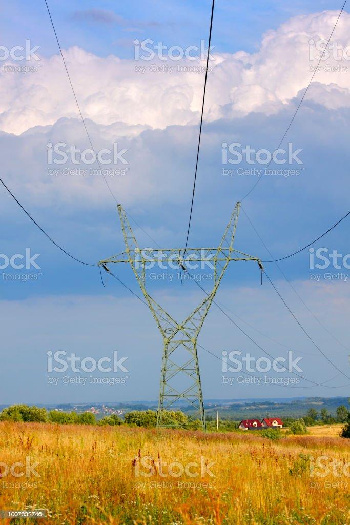 Landscape with electricity transmission pylon stock photo