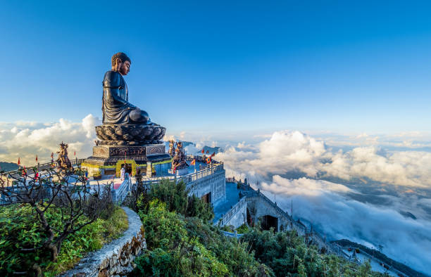 Landscape with Giant Buddha statue on the top of mount Fansipan