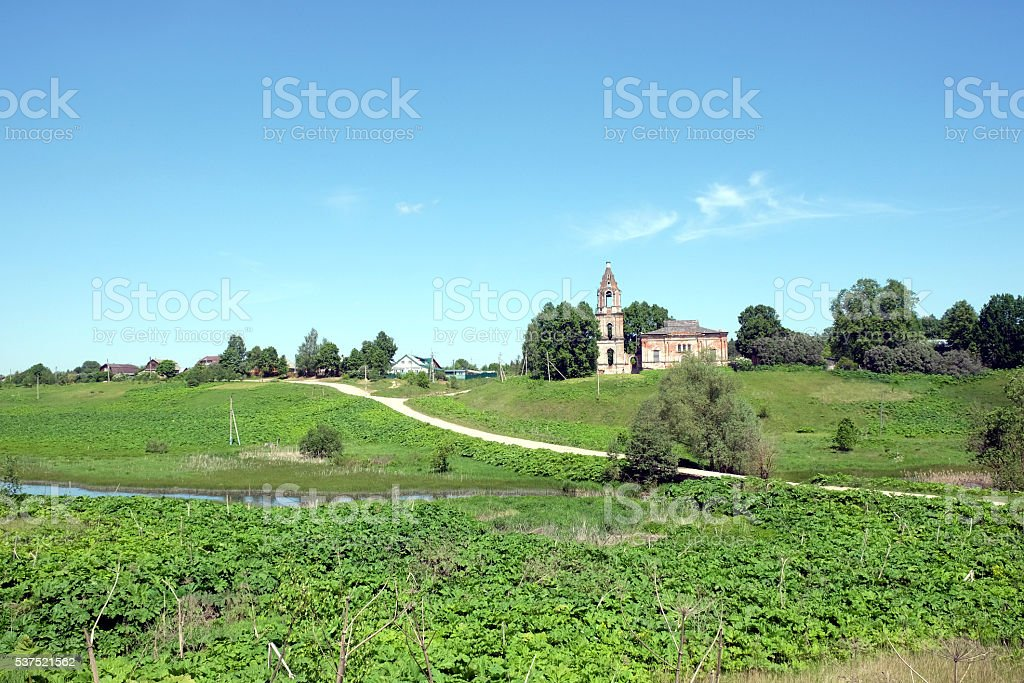 Landscape with hills, river, a village and christian church ruins stock photo