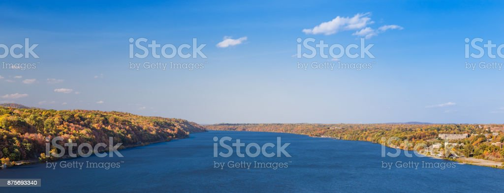 Landscape with Hudson River, Trees in Autumn Colors (Foliage) and Blue Sky, Poughkeepsie, Hudson Valley, New York. stock photo