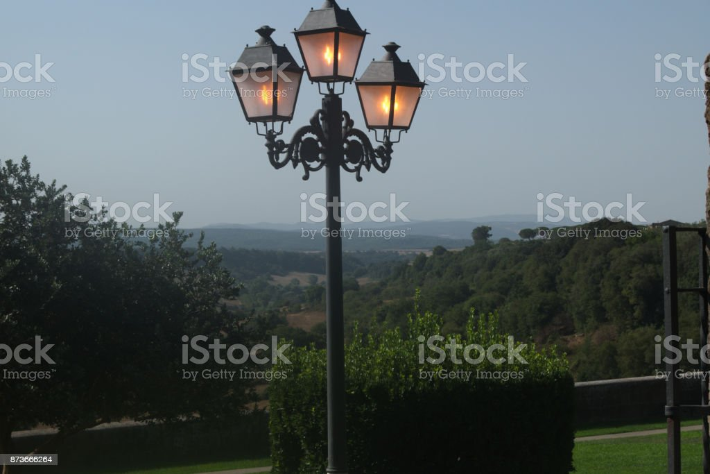 Landscape with lamp post in foreground stock photo