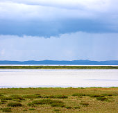 Landscape with land river and blue rain clouds