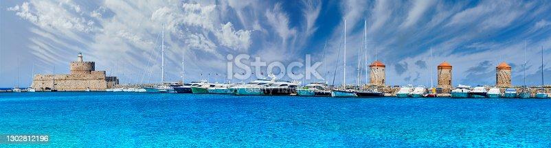 istock Landscape with Mandraki Harbour 1302812196