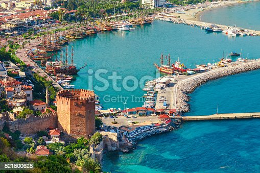 istock Landscape with marina and Kizil Kule tower in Alanya peninsula, Antalya district, Turkey, Asia. Famous tourist destination with high mountains. Part of ancient old Castle. Summer bright day 821800628