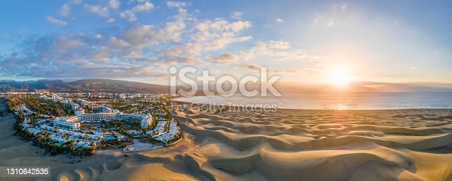 istock Landscape with Maspalomas town and golden sand dunes at sunrise 1310642535