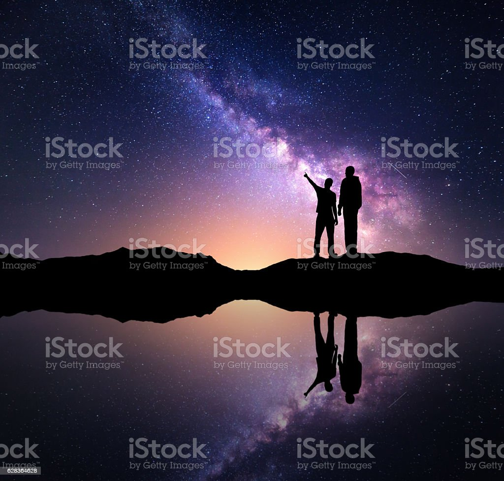 Landscape with Milky Way and men. Silhouette of a people - foto stock