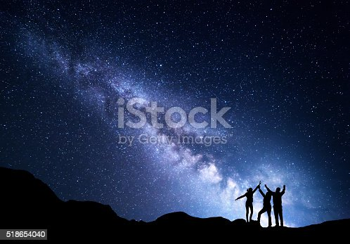 istock Landscape with Milky Way and silhouette of a happy family 518654040