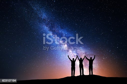 istock Landscape with Milky Way and silhouette of a happy family 623107194