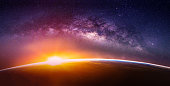 istock Landscape with Milky way galaxy. Sunrise and Earth view from space with Milky way galaxy. (Elements of this image furnished by NASA) 1133301909