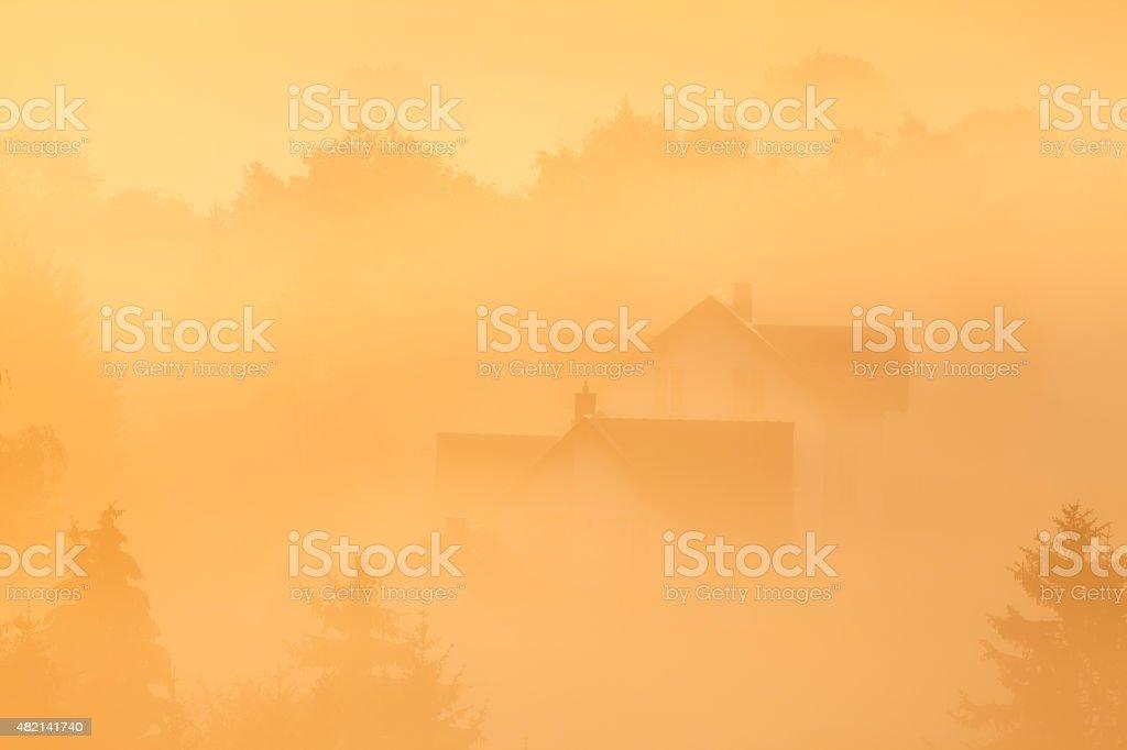 Landscape with mist and fog, beautiful sunrise, Grönebach, Sauerland, Germany stock photo