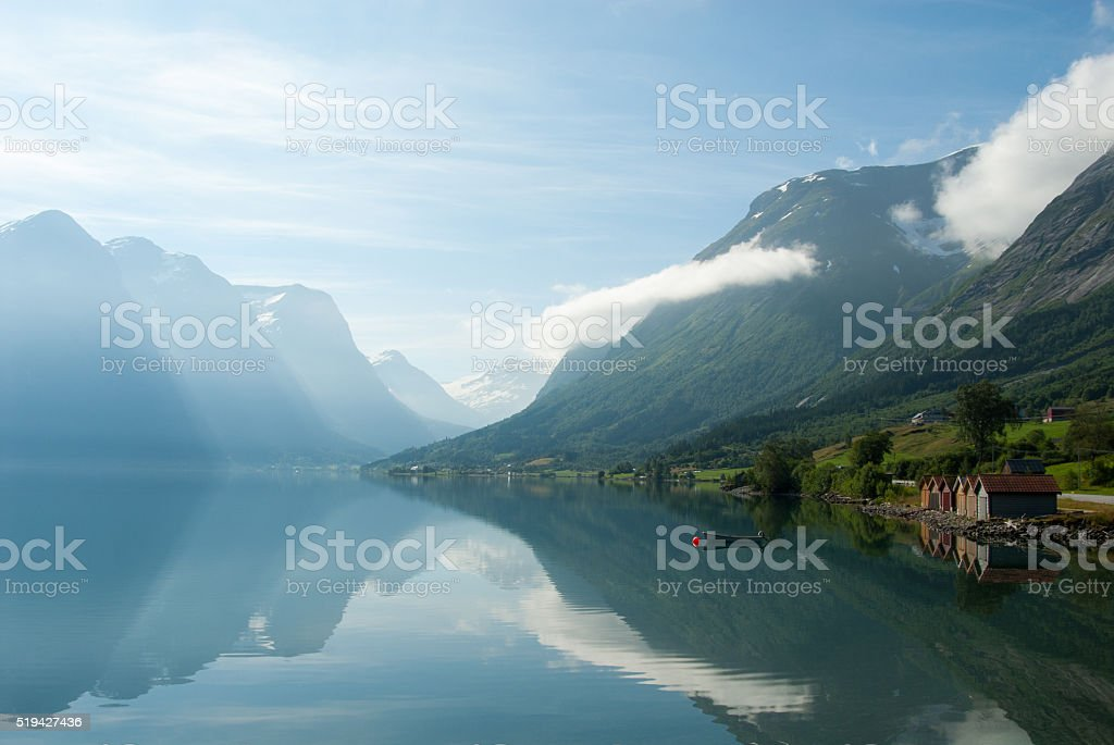 Landscape with mountains reflecting in the lake, Norway stock photo