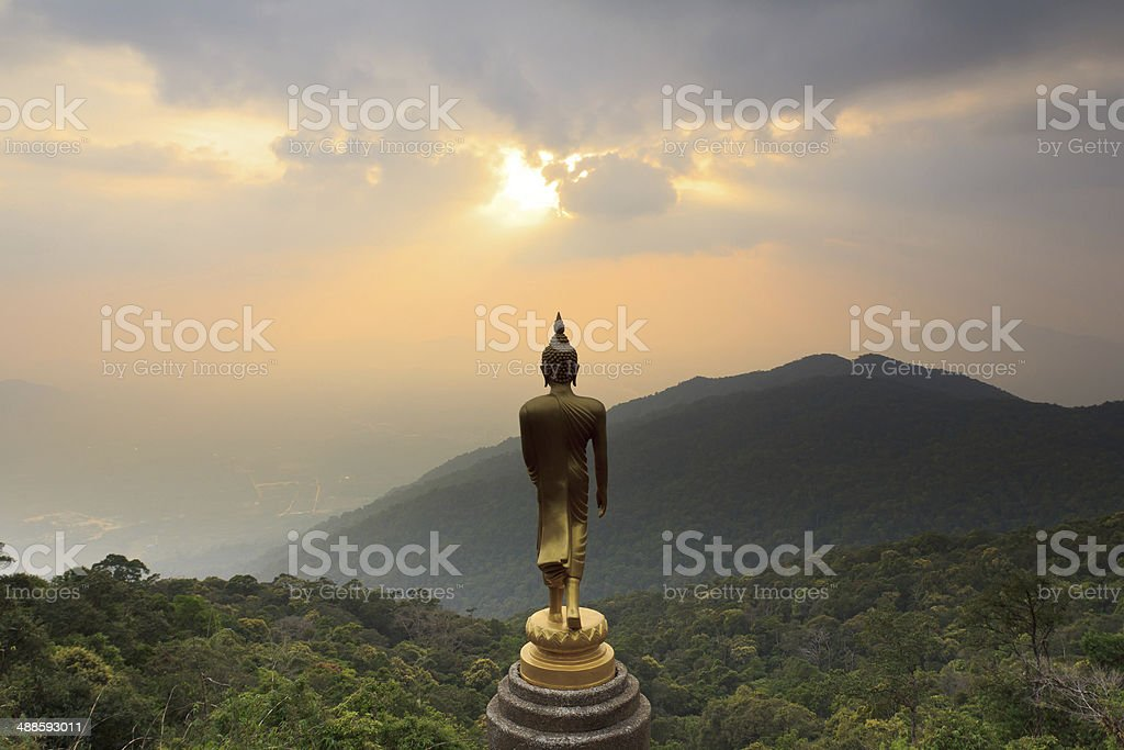 Landscape with mounts and Buddha statue,Thailand stock photo