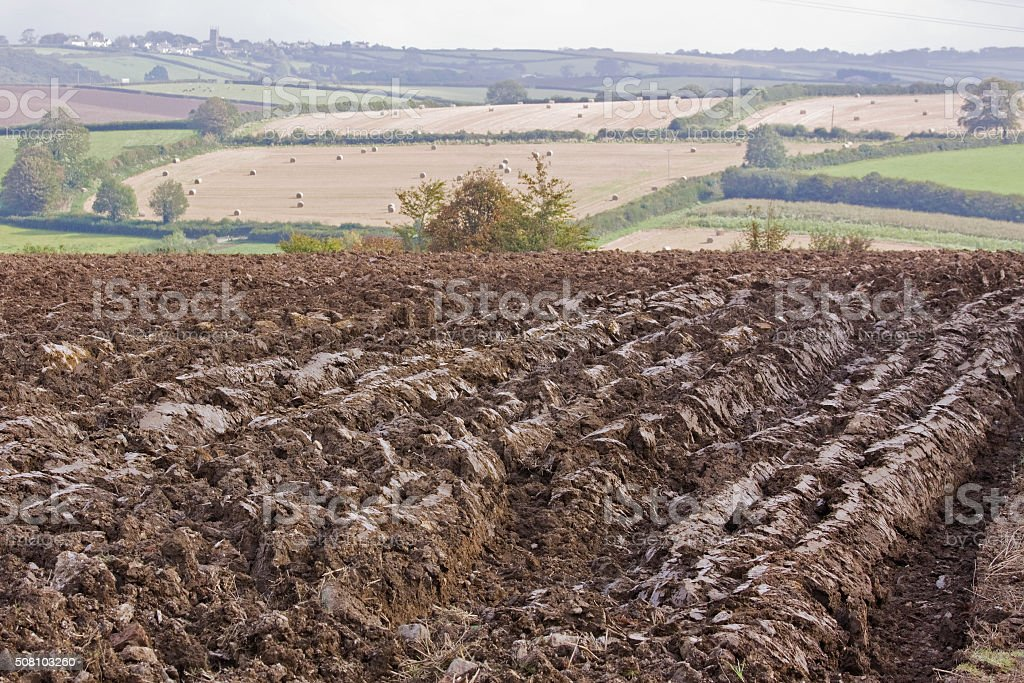 Landscape with ploughed field shortly after harvest in Devon UK stock photo