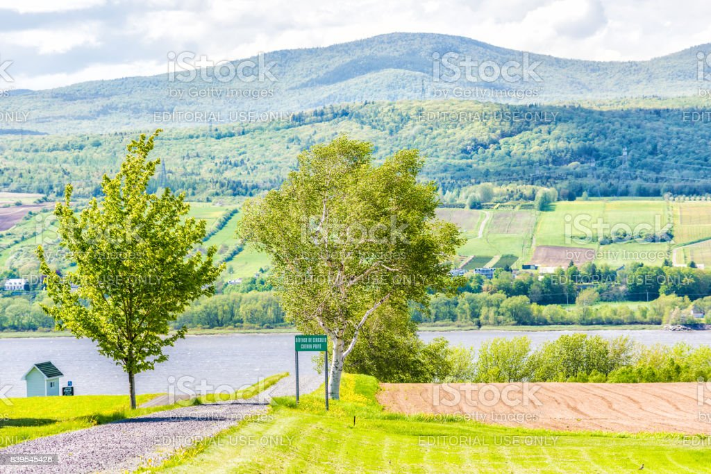Landscape with plowed field in summer and trail path road with private sign stock photo